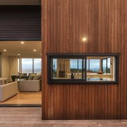 Timber lines this outside wall in typical NZ architecture, floor, flooring, house, interior design, lobby, real estate, window, wood, brown