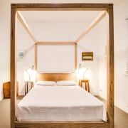 The bedroom – located in the older part bed, bed frame, bedroom, ceiling, daylighting, floor, furniture, home, interior design, real estate, room, suite, window, wood, white