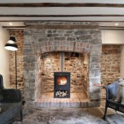 Like a Russian doll, a new fireplace sits fireplace, hearth, interior design, living room, wood burning stove, gray