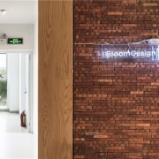 The sign hangs on the brick wall brick, floor, flooring, hardwood, interior design, tile, wall, wood, wood flooring, wood stain, brown, white