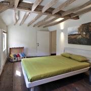 A 'floating' bed makes the room feel that bed frame, bedroom, ceiling, estate, interior design, loft, property, real estate, room, gray