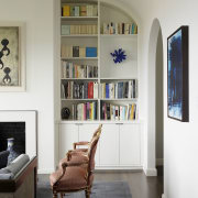 The bookshelf here follows the curvature of the bookcase, ceiling, floor, furniture, home, interior design, living room, room, shelf, shelving, wall, window, white, gray
