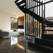 Another view of the stairway and living area interior design, living room, property, real estate, black, gray