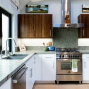 The kitchen features ample work space and an cabinetry, countertop, cuisine classique, floor, interior design, kitchen, gray