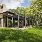 The sheltered outdoor area flows out onto the architecture, cottage, estate, farmhouse, home, house, landscape, property, real estate, brown