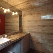 The use of red in the living area architecture, bathroom, ceiling, floor, flooring, interior design, property, real estate, room, tile, wall, wood, brown