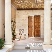 The European influences are clear in this entryway, column, estate, property, real estate, structure, white