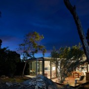 It's a paradise in the bush architecture, atmosphere, cloud, darkness, evening, home, house, landscape, lighting, night, phenomenon, real estate, residential area, sky, tree, black, blue