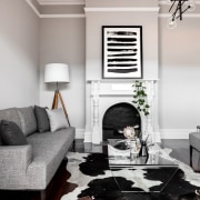 The old fireplace remains as part of the ceiling, floor, furniture, home, interior design, living room, room, table, wall, window, wood, gray