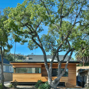 The architect paid close attention to the home's architecture, cottage, home, house, plant, property, real estate, residential area, tree, woody plant, green