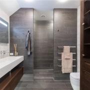 Even a simple, high quality towel rail can bathroom, floor, flooring, interior design, room, tile, gray, black