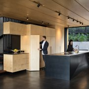 Slender benchtops, minimalist joinery and folded metal planes architecture, ceiling, countertop, floor, flooring, furniture, house, interior design, kitchen, black, brown