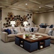 A unique pattern running along the wall draws ceiling, furniture, interior design, living room, room, brown, gray