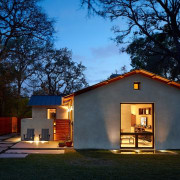 The pavers extend around side of the home architecture, cottage, estate, evening, facade, home, house, lighting, property, real estate, roof, shed, sky, villa, black, blue