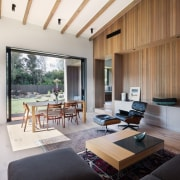 The living area features tall cedar walls architecture, ceiling, house, interior design, living room, property, real estate, white