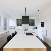 Bar seating within the kitchen itself means the architecture, countertop, house, interior design, kitchen, product design, real estate, room, white
