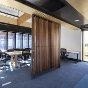 This slat feature wall adds an element of ceiling, interior design, real estate, white