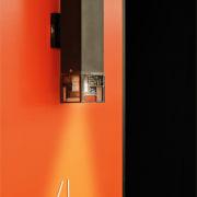 One of the outdoor lights heat, light fixture, lighting, orange, product design, red, black