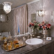 An expansive mirror certainly makes the room feel bathroom, ceiling, countertop, dining room, home, interior design, kitchen, room, sink, gray