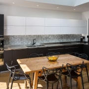 The ovens sit off to the side, meaning countertop, interior design, kitchen, real estate, gray, black