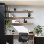 This clever shelf provides more space above the bookcase, desk, furniture, interior design, product design, shelf, shelving, wall, gray, white