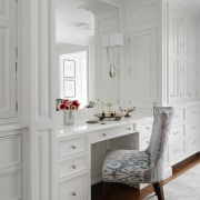 This vanity has easy access to draws and cabinetry, chest of drawers, floor, flooring, furniture, home, interior design, room, table, wall, window, gray