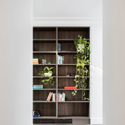 These wood cabinets stand out from the hallway bookcase, furniture, house, interior design, shelf, shelving, white
