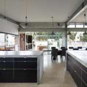 Step from the kitchen into the sheltered outdoor countertop, house, interior design, kitchen, real estate, window, gray