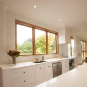 TIDA NZ 2017 – Designer kitchen entrant – cabinetry, ceiling, countertop, daylighting, floor, flooring, home, house, interior design, kitchen, real estate, room, sink, window, gray, brown