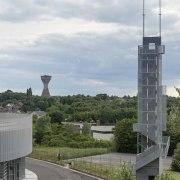 569 firestation building, sky, tower, gray, white