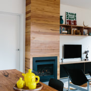Timber runs throughout the home – across the floor, flooring, furniture, hardwood, hearth, home, house, interior design, living room, room, table, wall, wood, wood flooring, gray