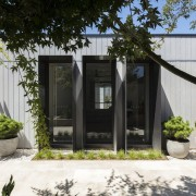 A sheltered courtyard area is one of the architecture, backyard, cottage, facade, home, house, outdoor structure, property, real estate, shed, black