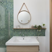Green tiles from the shower run along the bathroom, bathroom accessory, bathroom cabinet, home, interior design, plumbing fixture, product design, room, sink, tap, gray