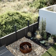 An outdoor fire pit is perfect for a backyard, garden, grass, landscape, landscaping, outdoor structure, plant, walkway, yard