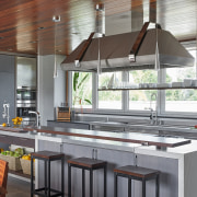A low timber shelf on this kitchen's cooking countertop, interior design, kitchen, gray