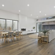 It's a cavernous space, with more than enough floor, flooring, hardwood, house, interior design, laminate flooring, living room, property, real estate, wood flooring, gray