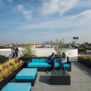 Matching blue seats and tables add colour to leisure, property, real estate, resort, roof, swimming pool, gray