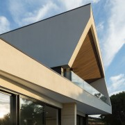 This angled roof channels your view to the architecture, building, corporate headquarters, daylighting, facade, home, house, real estate, residential area, roof, shade, siding, sky, window