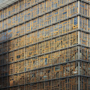 This new headquarters for the European Union Council apartment, architecture, building, city, condominium, daytime, facade, metropolis, metropolitan area, residential area, scaffolding, sky, skyscraper, tower block, urban area, window, gray, black