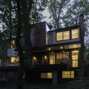 Extensive fenestration is essential in a forest architecture, building, cottage, facade, home, house, property, real estate, siding, tree, black
