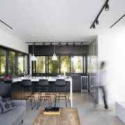 The kitchen flows into the living area house, interior design, living room, property, real estate, white
