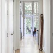 Expansive windows permit views of the yard ceiling, door, floor, flooring, hall, hardwood, home, interior design, property, real estate, window, wood flooring, gray, white