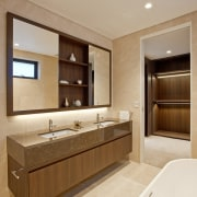 Wood and marble feature in this bathroom and bathroom, bathroom accessory, bathroom cabinet, cabinetry, interior design, room, sink, orange, brown