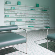 Sergio Mannino Studio designed this pharmacy to be floor, furniture, glass, interior design, product, product design, table, wall, gray