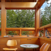 The windows in this space connect the room architecture, deck, furniture, home, house, interior design, living room, outdoor structure, porch, real estate, table, window, wood, brown