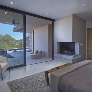 The master bedroom features a breathtaking outlook architecture, fireplace, floor, hearth, house, interior design, living room, property, real estate, room, gray