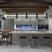 A smaller table sits off to the side countertop, interior design, kitchen, table, gray, black