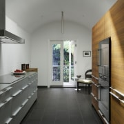The kitchen opens out to the courtyard architecture, countertop, floor, house, interior design, kitchen, gray