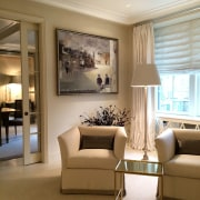 Art on display in the living area ceiling, floor, flooring, furniture, home, interior design, living room, lobby, room, wall, window, brown