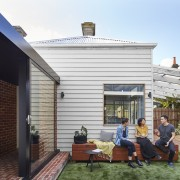 Retaining elements of the the old while adding backyard, daylighting, facade, home, house, outdoor structure, property, real estate, residential area, roof, siding, window, white, black